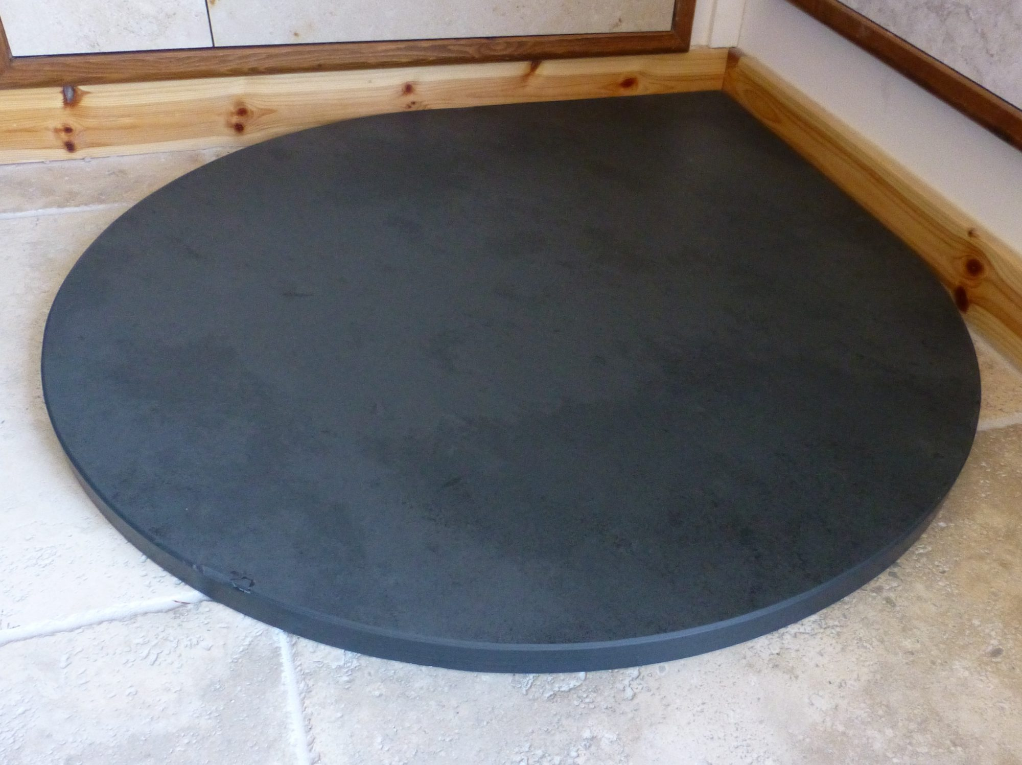 This is a Brazilian Grey/Black Slate Hearth cut by ourselves to a teardrop shape.Just an example of the cuts we can make to fit your needs.