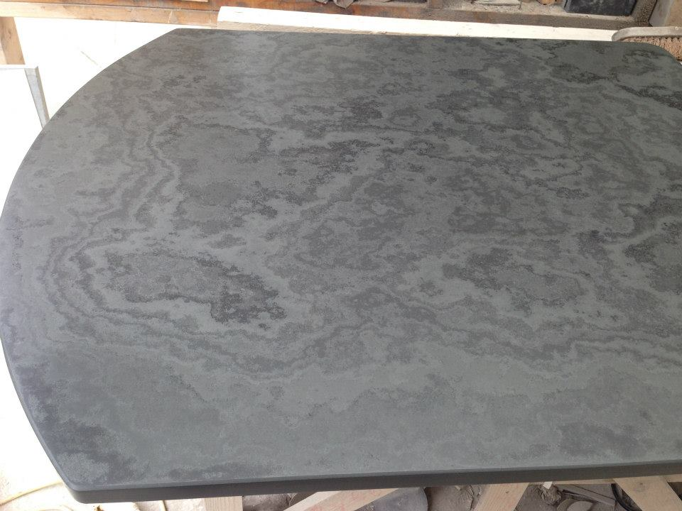 A Brazilian Slate Hearth Polished to bring out surface detail